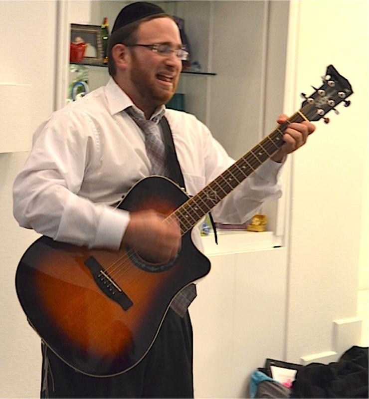 Rabbi Michel Lomner, program director for NCSY in Dallas, led the singing during the organization's fourth-night celebration for teens Dec. 11.|Photo: Yaakov Rosenblatt