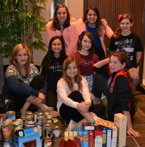 Sixth grader Sydney Bennett, seated front and center, was joined by seven of her Brentfield classmates for a unique scavenger hunt benefitting multiple charities. Shown are (front row from left) Megan Droste, Bennett, Ailis Wynne; middle row from left Camryn Strickland and Lily Flandorfer; and top row from left, Helena Kaplan, Jacquelyn Bodzy and Dena Levy. | Photo: Scott Bennett