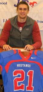Aaron Moss signed a national letter of intent Feb. 6 to play football at Henderson State University. | Photo: Courtesy Randy Robertson