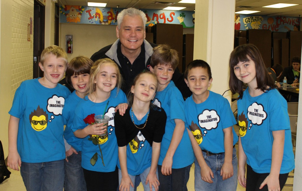Brentfield Elementary School principal Steve Lemons congratulates the Imaginators, all third-graders, who will represent Brentfield at the Destination Imagination state competition in Katy. | Photo: Anne Howard