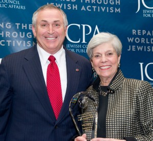 Marc Stanley of Dallas receives the Jewish Council of Public Affairs' Tikkun Olam Award from former JCPA chair Lynn Lyss during the organization's annual plenum. | Photo: Risdon Photography/JCPA