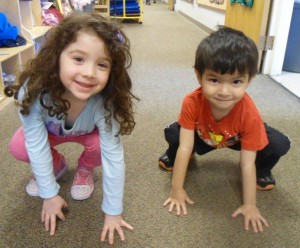 Students Brianna Solomon and Saul Rosen learn about the Ten Plagues by  jumping around as frogs. | Photo: Submitted by Shelly Sender