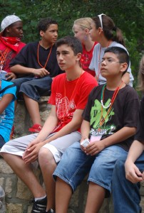 Sam Weiger, forefront left, with campers during Camp Impact.