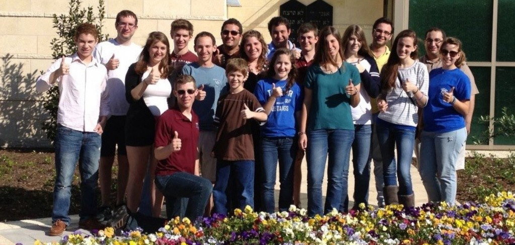 High school students and their families stand in front of the A.I. and Manet Schepps Hillel Building at Texas A&M University during the Aggie Jewish Open House Weekend April 19-21. | Photo: Trudi Herstein
