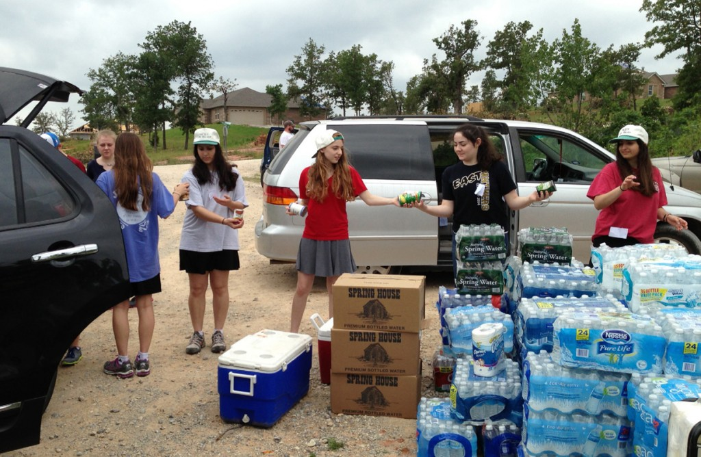Dallas-area teens, from left, Cayli Fowler, Carolyn San Soucie, Sofia Joison, Clara Wohlstadter, Erin Van Creveld and Niv Avneri form a chain of caring to supply drinks and food to the residents of Moore, Okla. | Photos submitted by NCSY/Dallas