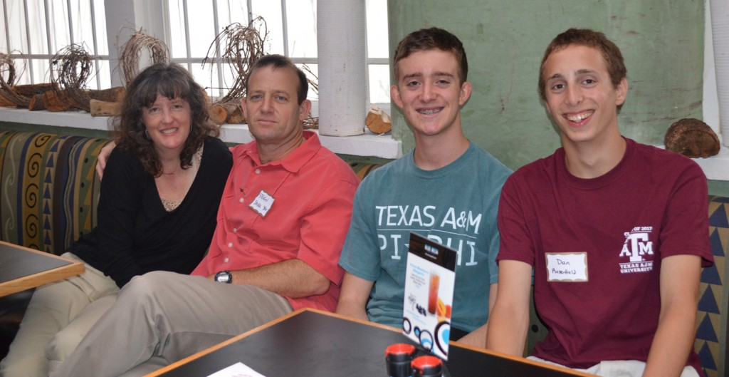 Andrea and Steven Solka, an Aggie alum, with their son, Matt, a rising sophomore and Dan Rosenfeld, an incoming freshman. Matt and Dan are both members of the Corps of Cadets.