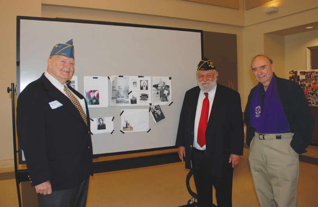 George Sepp, Julian Haber and Ken Sherwin with photos of some of their military service. | Photo: Courtesy of Barbara Rubin