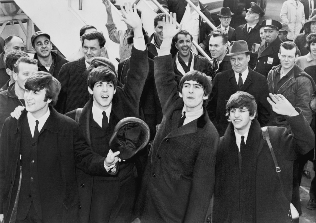 "The Beatles, pictured here waving to fans after arriving at John F. Kennedy Airport in New York in February 1964, makes the JNS.org Chanukah playlist with ""Eight Days A Week."" 