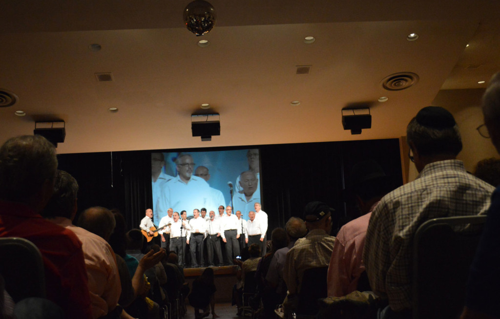 "Congregation Anshai Torah's a cappella group, Kol Rina, sings ""Akheinu"" during the vigil at the Aaron Family JCC Monday night. 