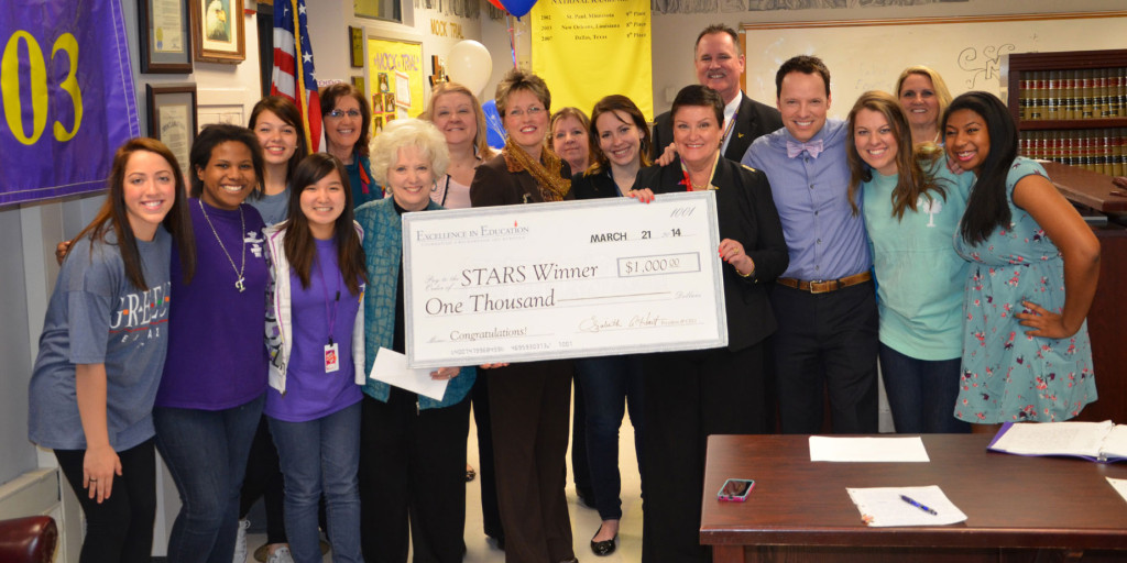 RISD Law Magnet Director Alexis Stern, fourth from right, was one of 10 teachers selected as RISD's STARS (Superior Teaching Achievement in RISD Schools) Teachers of the Year. She is shown here with the 'prize patrol' and RISD Superintendant Dr. Kay Waggoner to Stern's left.   Photo: RISD