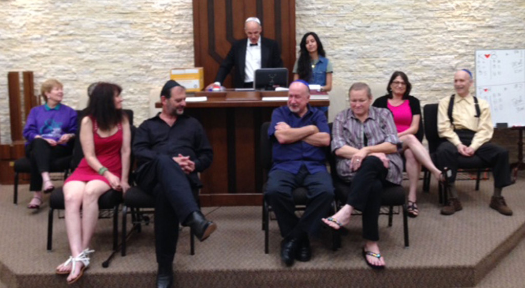 """Randy San Antonio and Davina Sassoon pose the questions to """"Not So Newlywed Game"""" contestants at the Congregation Beth Shalom sanctuary dedication June 27. From left, Brian and Klila Caplan; Phillippe and Judy Lecoq; Henry and Debra Kaplan; and Ben and Fran Weiger. 