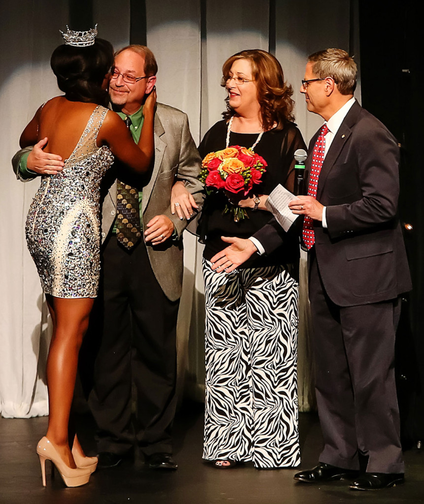 Miss Texas 2013 Ivana Hall welcomed Ruthie Currie and Herb Bogart to the Eisenmann stage as Marvin Blum looks on. The preliminary show of the Miss Texas Pageant July 2 was dedicated to the memory of Ann Bogart.