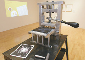 "Saul Schisler created this traditional printing press, which took him roughly 350 hours to complete. The piece is part of an exhibit called ""Pratt Celebrates 125 Years of the Wall Street Journal"" at the Pratt Manhattan Gallery."