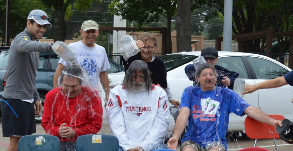 "Dr. Zev Shulkin, Ed Jerome Julie Doucet and Nancy Walker give the ""Ice bucket"" treatment to Rick Cohen, Peter Lesser and Stuart Roosth."