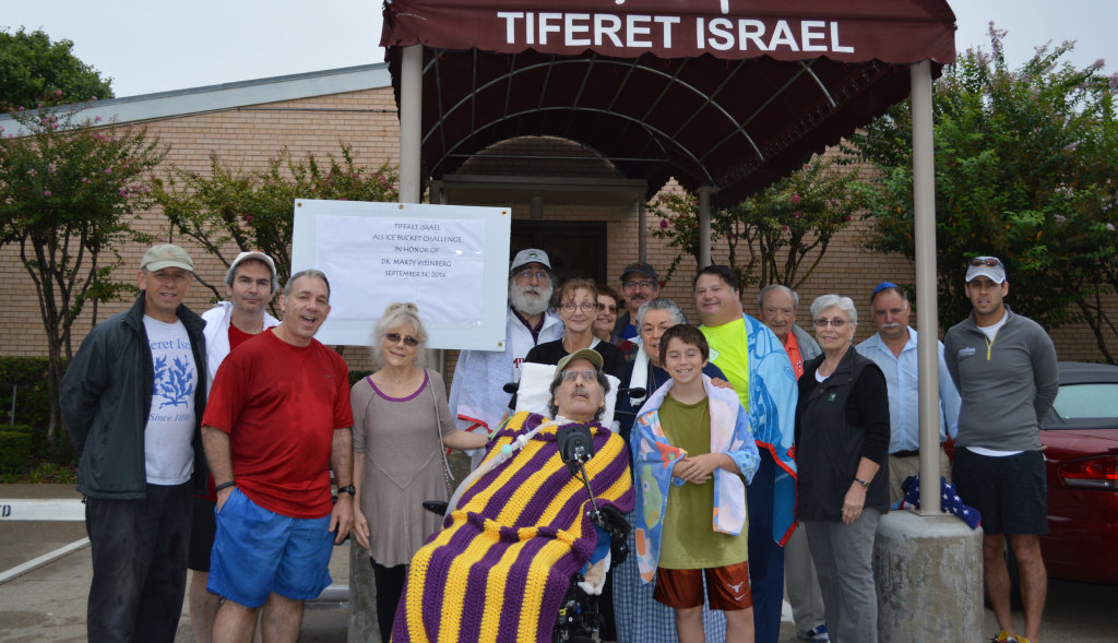 At the Tiferet ALS Ice Bucket Challenge in honor of Marty Weinberg Sept. 14 are, from left, Ed Jerome, Warren Abrams, Rick Cohen, Elandra Weinberg, Marty Weinberg and Joseph Blashka; second row Julie Doucet, Sonia Meltzer, David Bock and Shirley Rovinsky; and back row Peter Lesser, Tina Israel, Stuart Roosth, Irv Rovinsky, Ilya Kisin and Zev Shulkin