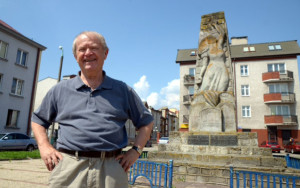 Dr. Charles Silver is pictured in front of a memorial at the site of the former great synagogue in Radom, Poland.
