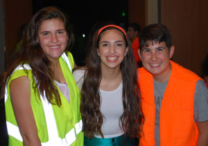From left, Normandy Toledo, Jenna Narosov and Jared Steinhart at the Morton Arthur Lewis Neon Dance Sept. 6.