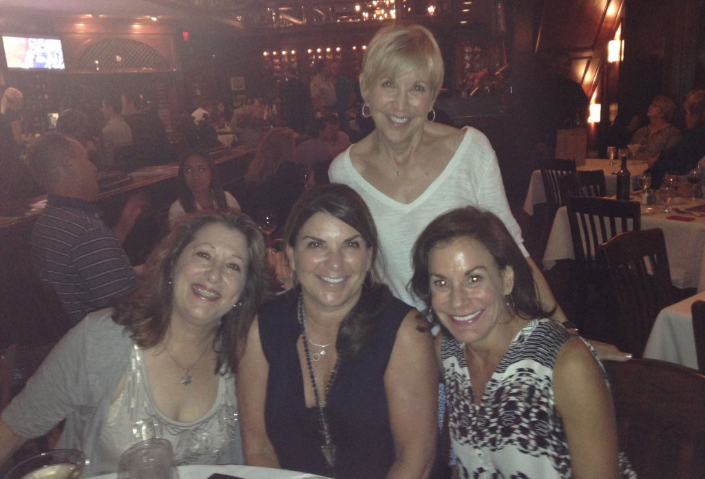 From left, Ruthie Bogart Currie, Barbara Beckoff Leigh, Susan Wisch and Judy Beckoff Nussenblatt (standing) enjoy dinner at Del Frisco's in Fort Worth earlier this month. Barbara and Judy were in town visiting their favorite childhood haunts.