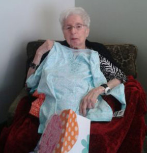 Esther Rosen shows off some of her new clothes she received for her 94th birthday last month.