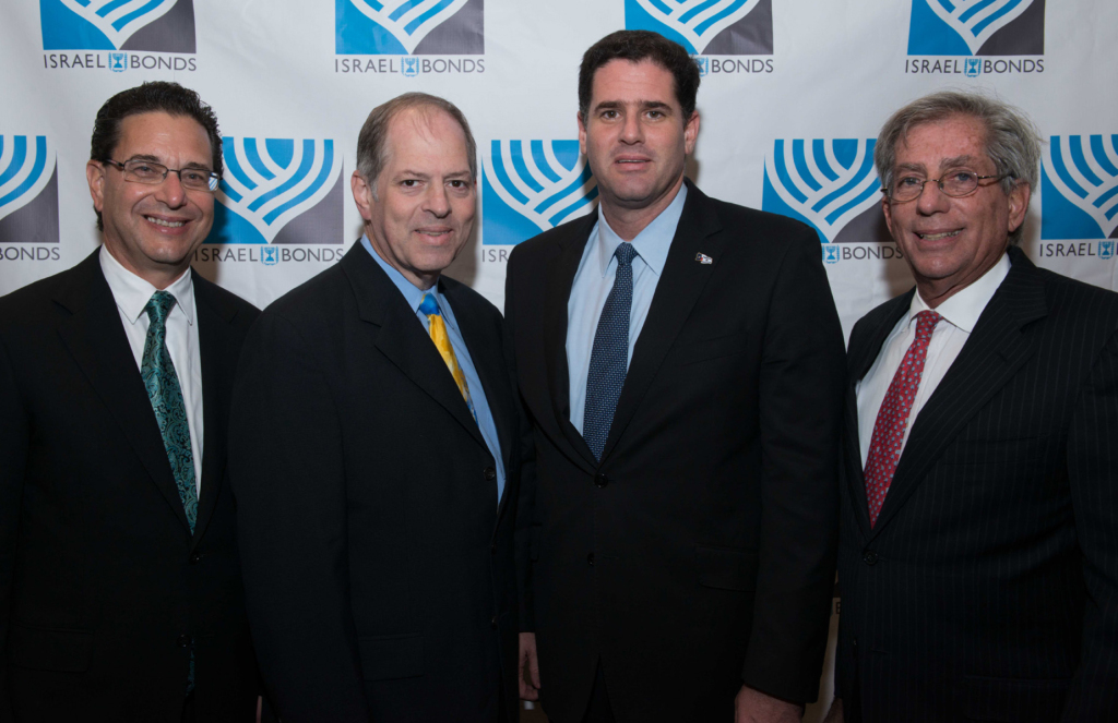 Dallas Israel Bonds Chair Kenny Goldberg and other members of the Israel Bonds regional leadership recently met with Israel's Ambassador to the United States Ron Dermer on his visit to Houston, where he expressed his gratitude of the Southwest Region's considerable investment in Israel. Pictured from left are Dallas Chair Kenny Goldberg, Houston Chair Steve Finkelman, Ambassador Ron Dermer and National Campaign Chair Fred Zeidman. | Photo: Marc Nathan Photography