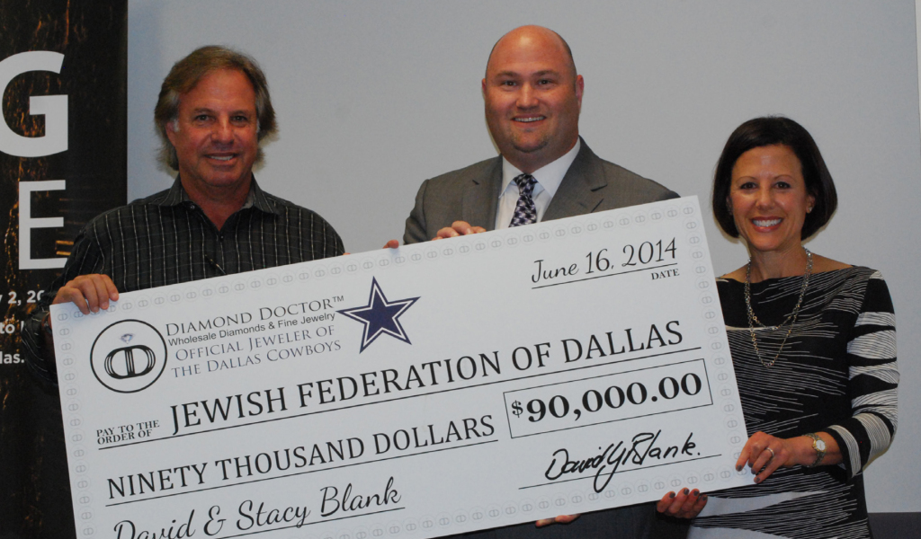 Graham Silberman of Diamond Doctor presents their corporate sponsorship check of $90,000 to the Jewish Federation of Greater Dallas. Diamond Doctor is the presenting sponsor of the Federation's Men's Event 2014-2016. Accepting the check is Bradley Laye, President & CEO, Jewish Federation of Greater Dallas and Cindy Sweet Moskowitz, board chair, Jewish Federation of Greater Dallas. | Photo: JFGD