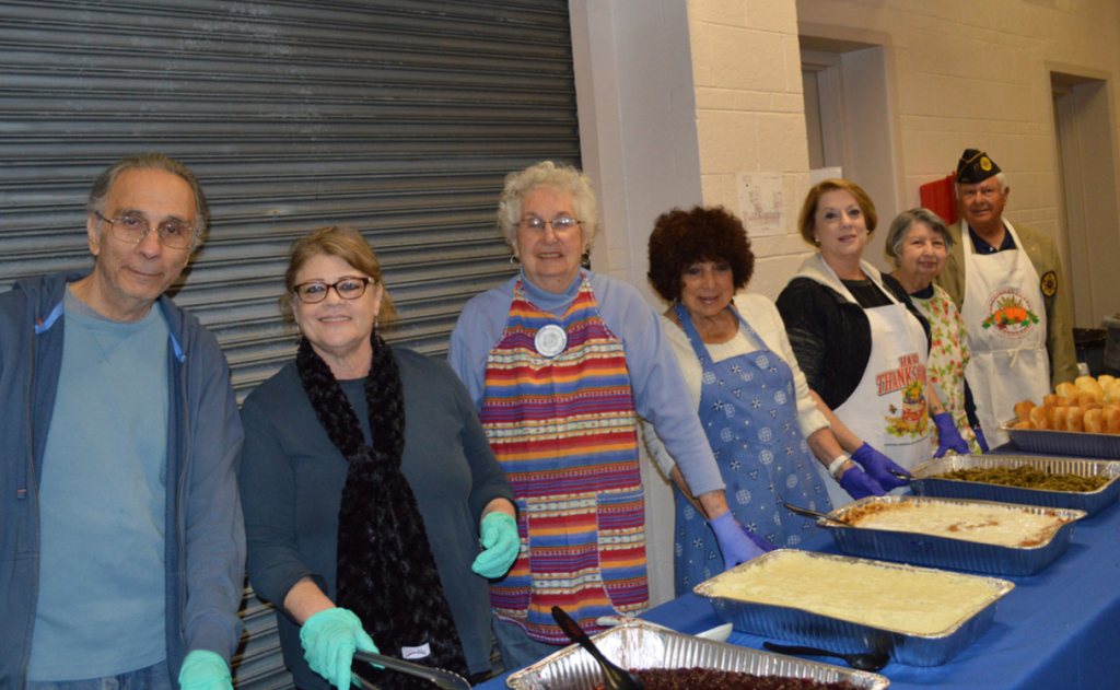 Serving food at the luncheon are, from left, Howard Weinberg, Jeanie Tolmas, Sunny Schor, Jean Jacobs, Shelley Byers, Ellen Feibel and Past Post Commander Dick Leathe.
