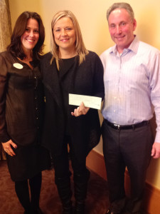Stephanie Hassan of the Legacy at Home, center, accepts a check on behalf of the Legacy Senior Communities from Lindsay Feldman and Mark Lowey representing the Jewish Business Alliance.