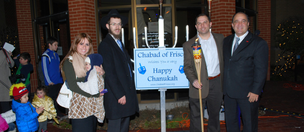Chabad lights up Frisco: On Tuesday, Dec. 16, the first night of Hanukkah, Chabad of Frisco held a Hanukkah celebration with a public menorah lighting and festivities for the whole family. More than 250 people attended the event. Pictured from left, Chabad of Frisco Directors Mrs. Mushkie and Rabbi Mendy Kesselman  and son Nosson, Frisco City Council Member Tim Nelson and Frisco Mayor Maher Maso. | Photo: G. Levine