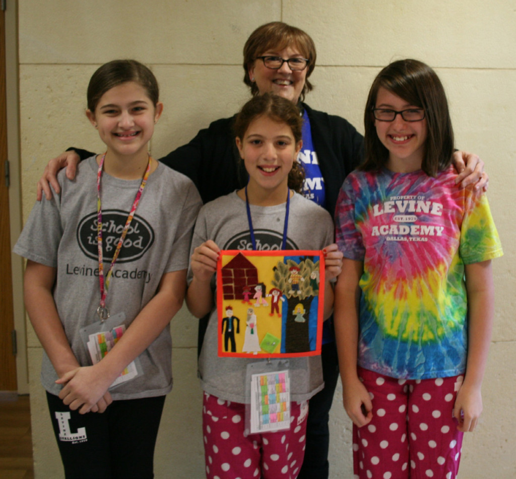 From left, art contest winners Jolie Reiman, Jordan Schildcrout and Sophie Krajmalnik with Levine Academy art teacher Wendy Cramer | Photo: Levine Academy