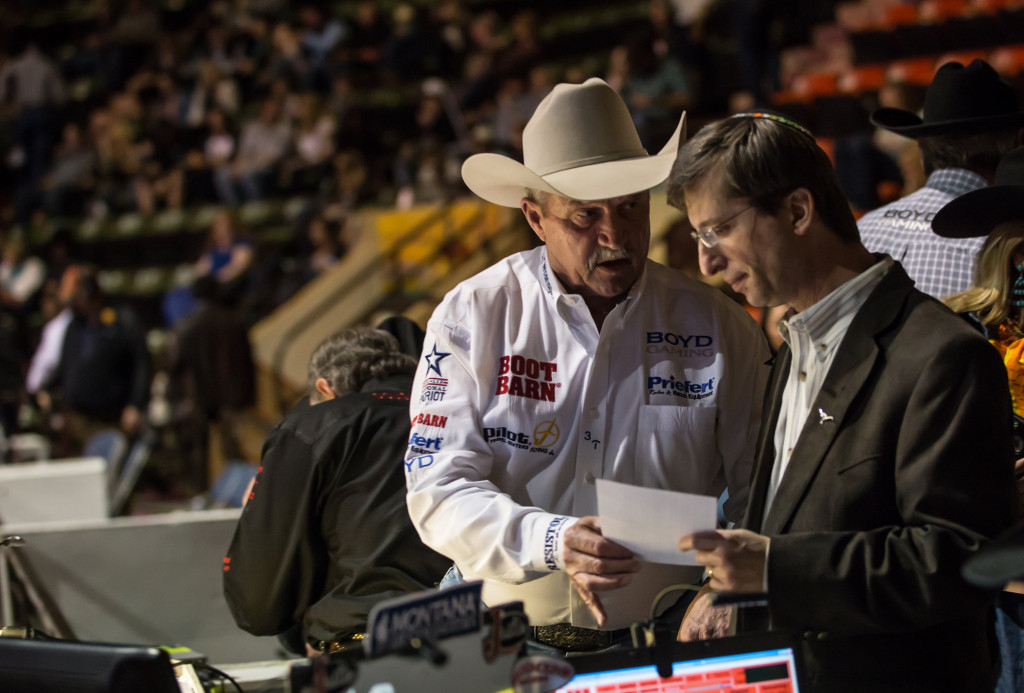 Longtime FWSSR public address announcer Bob Tallman visits with Rabbi Andrew Bloom prior to the first Jewish invocation at the sold-out event at Will Rogers Coliseum in Fort Worth, Feb. 7.   Photo: TJP/James Coreas