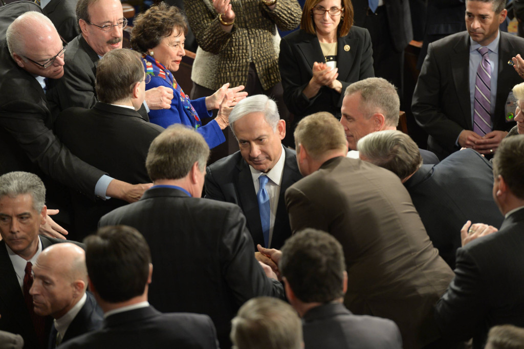 Israeli Prime Minister Benjamin Netanyahu is greeted by members of Congress at the joint session of Congress March 3. Observers said Republican Congressmen were quick to embrace him while Democrats tended to hang back. | Photo: GPO, Amos Ben Gershon
