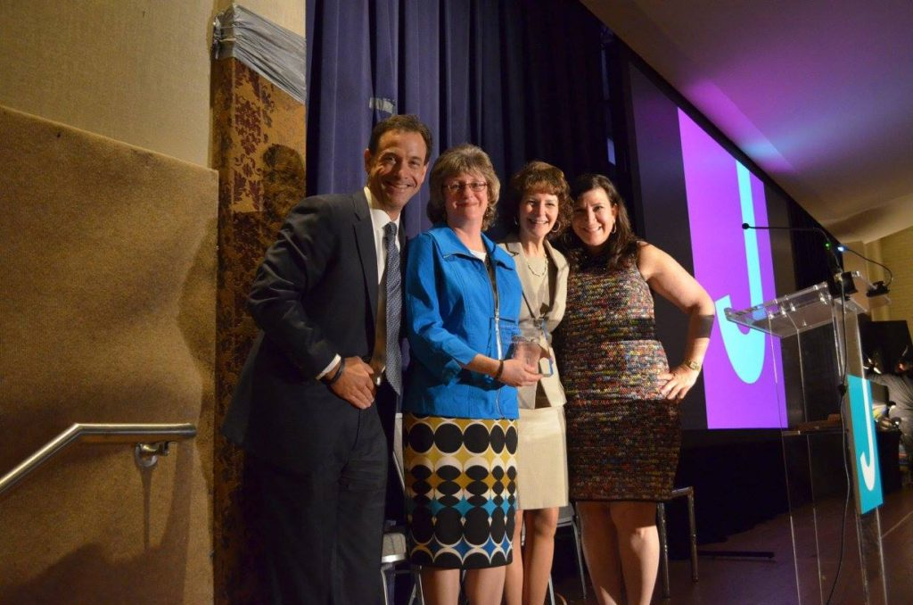 Chairs David Greenstone, Jill Tananbaum, and Lori Ordiway congratulate JCC Leader of the Year Liz Liener (second from left).