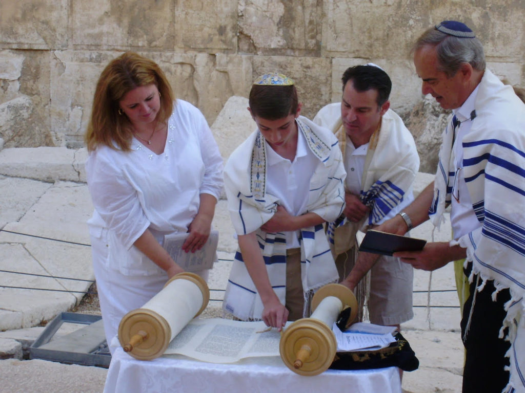 Cara and Barry Mendelsohn at the Torah as son Robert celebrates his bar mitzvah at the Kotel