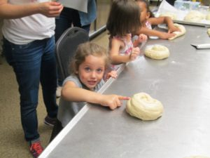 Challah bakers extraordinaire Submitted photos Charlotte Levi, Penny Kreiner and Liam Kuperman may have found the secret to perfect challah at a recent event.