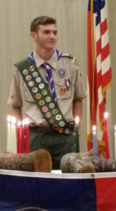 Noam Yosef earned his scarf and pin from the Boys Scouts. He coordinated landscaping for a special needs school in Baltimore.