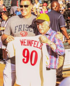 Frisco RoughRiders' General Partner and CEO President Chuck Greenberg (left) will be the featured speaker at the 42nd Annual Shalom League Softball League Awards  banquet on Dec. 11. In July, Greenberg welcomed Shalom League co-founder and banquet chair Bob Weinfeld to the mound to throw out the first pitch on the occasion of Weinfeld's 90th birthday.