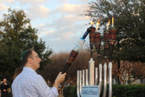 Steve and Marianne Noskin light the Hanukkah menorah in Frisco at the Chabad of Frisco community menorah lighting.