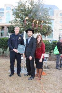 Rabbi Mendy and Mushkie Kesselman of Chabad of Frisco with Frisco Chief of Police John Bruce.