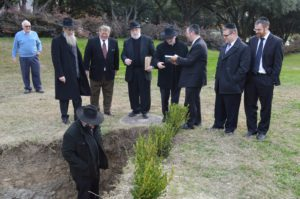 TTI Rosh HaYeshiva Rabbi Daniel Ringelheim inspects shaimos as other community rabbis look on.
