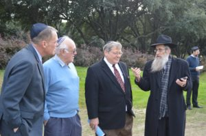 Rabbi Menachem Block (far right) discusses the possibility of adding more shaimos to the geniza a couple of years down the road, since there is room. Listening are (from left) Restland Director of Community Outreach Michael Wilfong, Cyril Sulski and Bill Finkelstein.