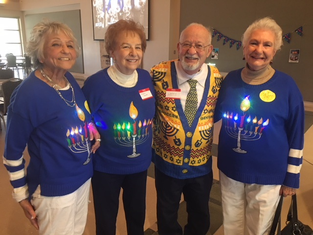 Daytimers celebrate Hanukkah, from left,  Rita Hoffman,  Barbara Schuster, Larry Steckler and Ceil Cantor