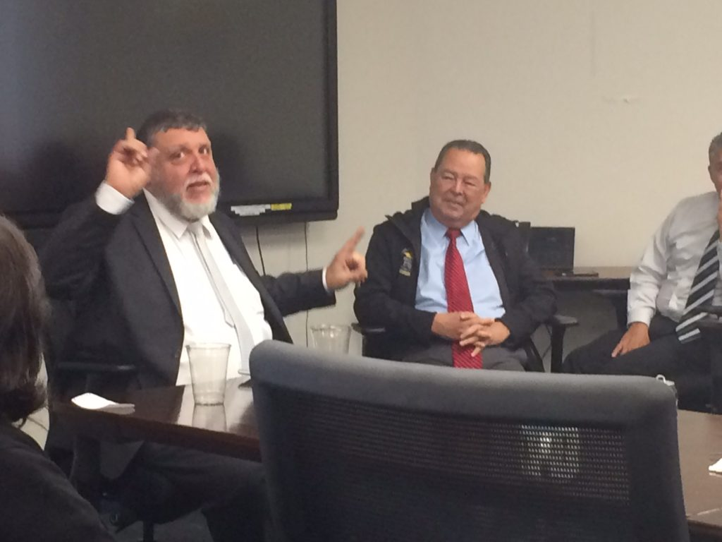 Submitted photo Rabbi Rafi (left) addresses administrators, board members and educators with Texans Can Academies President and CEO Richard Marquez.
