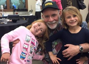 Dr. Michael Korenman poses with granddaughters Layla and Emeline. Korenman began surgical practice in 1979 and recently retired. Submitted photo
