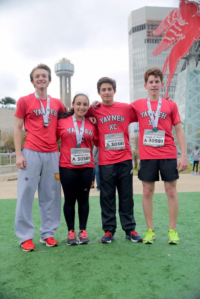 Submitted photo The Yavneh cross-country relay team (from left) — Griffin Levine, class of 2018; Rachel Sasson '18; Reece Parker '20; and Ezra Ruderman '19 — placed 22nd in their division in the Dallas Marathon on Dec. 13.