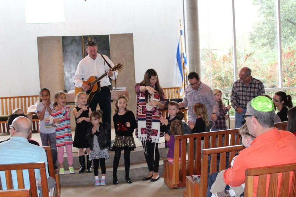 Photo: Lisa Rothberg Ray Farris and Rabbi Ariel Boxman lead Temple Shalom's first Young Family Hanukkah Service.