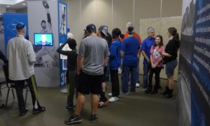 Photo: Jim Stanton Visitors enjoy the Chasing Dreams Baseball exhibit at Ahavath Sholom.