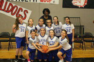 The fifth/sixth grade girls' basketball team: (back) Coach Lisa McCain (second row) Ella Fartook, Ruby Goldstein, Lilly Yalovsky, Dalia Lampert, Joey Davidsohn, Ilanit Reva; (front) Lily Feinstein, Ally Oster, Gabby Ido, Micah Sacher