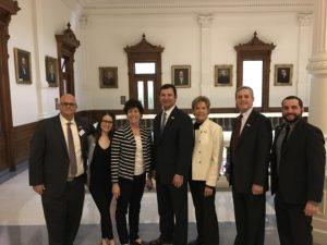 (From left) Joel Schwitzer, Gabriela Gorescu-French, Anita Zusman Eddy, State Rep. Craig Goldman, State Rep. Linda Koop, State Rep. Phil King, Jesse Stock