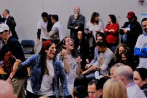 Fans celebrate the Bulldogs' victory that propelled Yavneh to its first TAPPS state tournament.