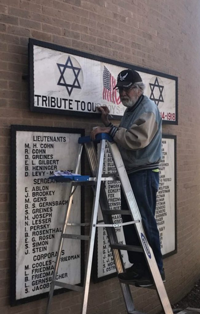 Submitted photo Landscaper Bob Sumien, a Catholic and Air Force veteran, works to restore the tribute.